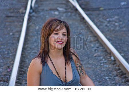 Woman Sitting On Tracks