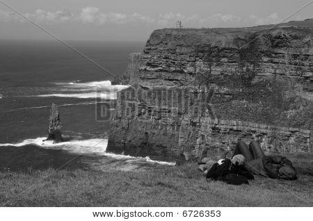 Scenic Seascape With Tourist On West Coast Of Ireland
