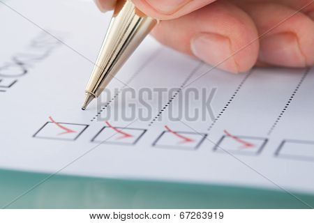 Cropped image of businessman preparing checklist at office desk poster