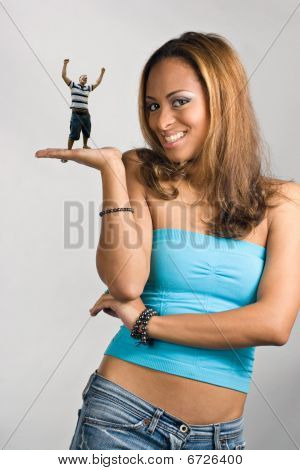 Girl Holding A Mini Man
