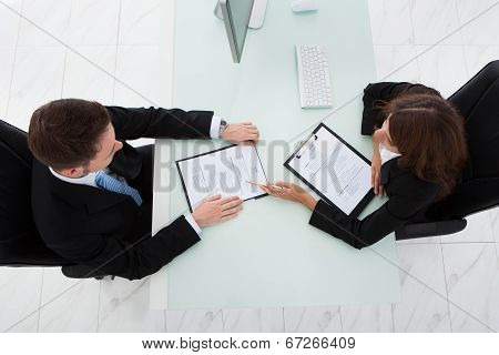 Businesswoman Interviewing Male Candidate In Office