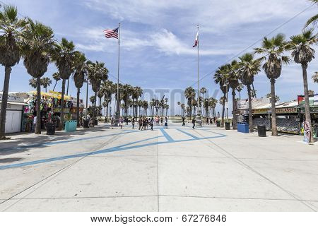 LOS ANGELES, CALIFORNIA - June 20, 2014:  Summer sun and palm trees at the funky Windward plaza at Venice Beach in Los Angeles, California.