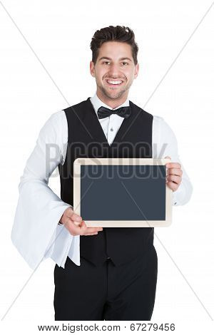 Smiling Young Butler Holding Blank Slate