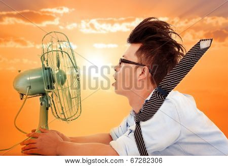 The Heat Wave Is Coming,business Man Holding A  Electric Fan