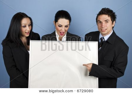 Surprised Businesspeople With Blank Sign