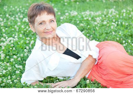 Beautiful Woman 50 In Park And Smiling