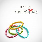 Colorful pearl bangles on grey background for Happy Friendship Day celebrations. poster