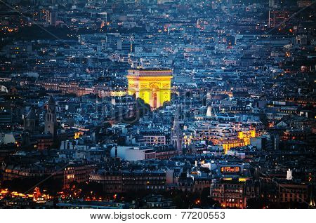 Aerial view of Arc de Triomphe de l'Etoile (The Triumphal Arch) in Paris at night poster
