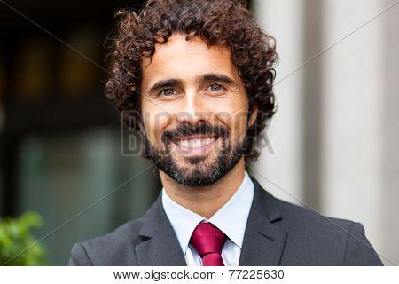 Portrait of an handsome businessman in an urban landscape
