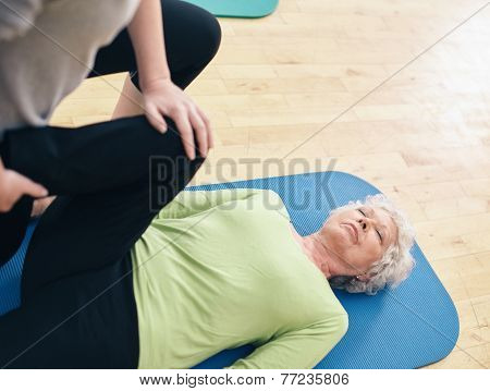 Elder Woman Receiving Physical Training From Her Personal Traine