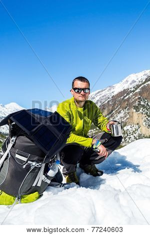 Man Hiker Camping And Resting In Winter Mountains