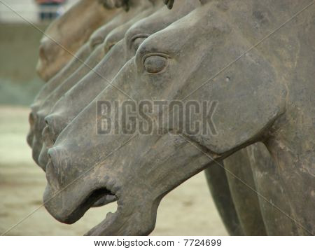 A row of terracotta horse statues in Xi'an China. poster