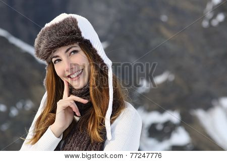 Woman Warmly Clothed Thinking In Winter