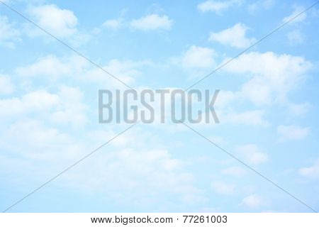 Light blue sky with clouds, may be used as background