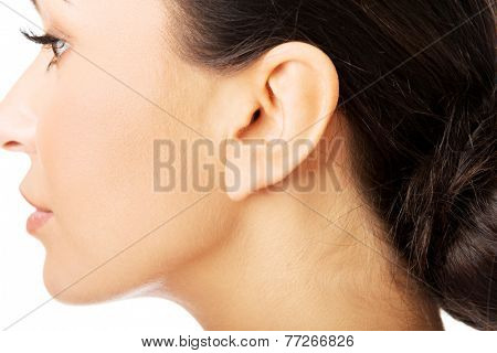 Closeup picture of woman's ear.