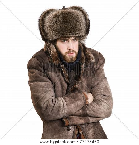 Young bearded man in the coat and earflaps hat, feel cold, isolated on a white background poster