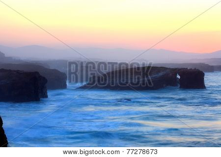 Beautiful sunset and stone arches on Playa de las Catedrales