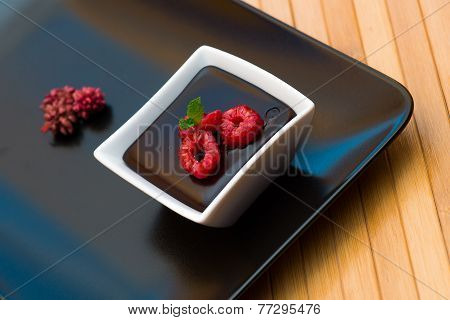Chocolate Dark Pudding With Raspberries