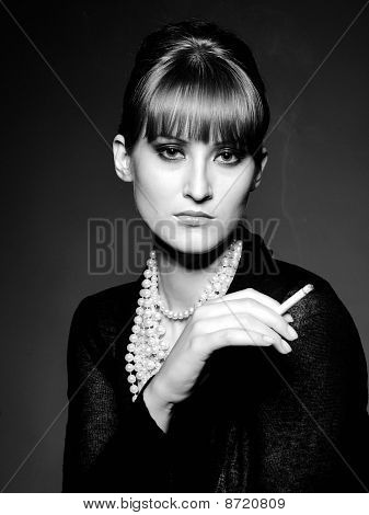 Beautiful Retro Woman With Red Lips Holding Cigarette And Smoking. Black And White Picture