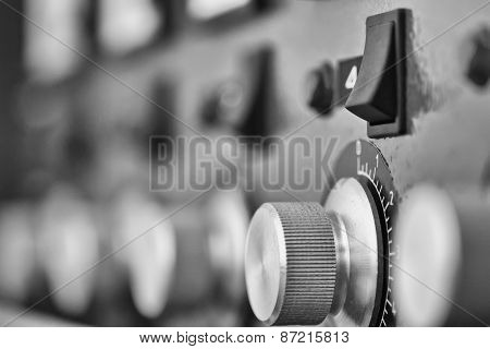 control panel with buttons and devices. Black and white
