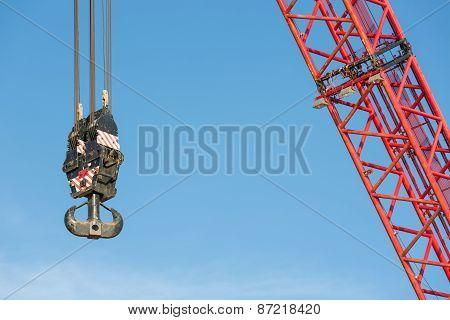 Red Crane Boom With Hook Against Blu Sky
