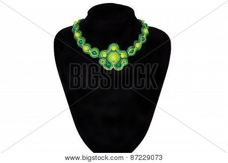 Green Necklace On A Rack