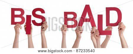 People Holding German Word Bis Bald Means Goodbye