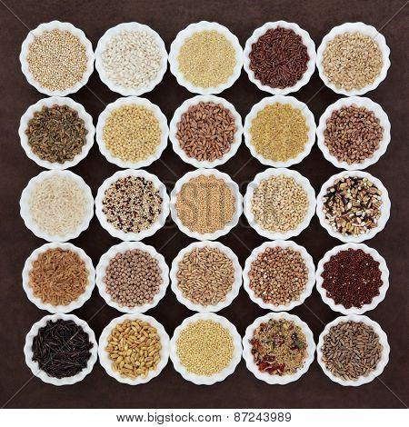 Large cereal and grain food selection in porcelain crinkle bowls over lokta paper background.  poster