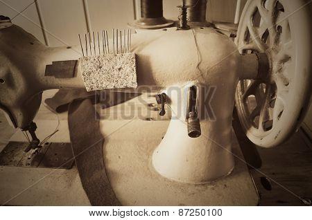 Handwheel Old Sewing Machine. Horizontal, Sepia, Monochrome