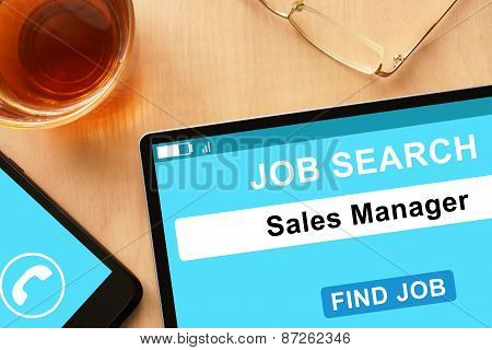 Tablet with Sales Manager on job search site.