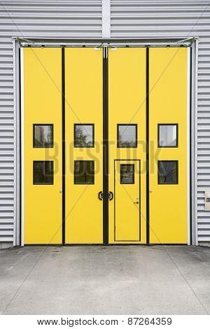Yellow Garage Door on a warehouse building