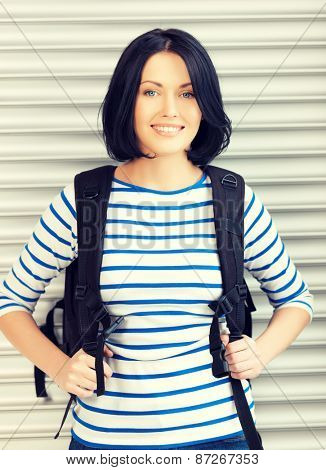 bright picture of attractive woman with bagpack..