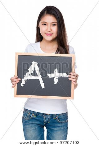 Young woman hold with chalkboard and showing mark A plus