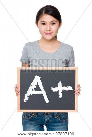 Woman hold with chalkboard and showing A plus mark