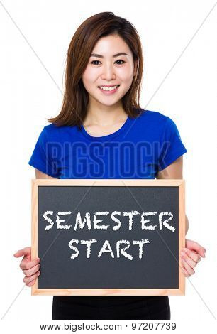 Asian woman hold with chalkboard and showing semester start