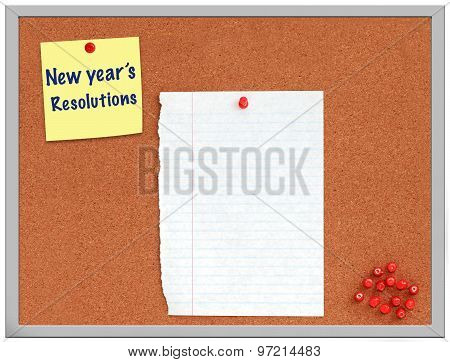 New year's resolutions note on cork board with white paper
