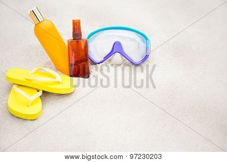 Beach Background - Flip Flops, Suntan Lotion Bottles And Diving Mask And Copy Space On The Sand