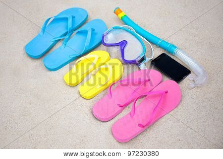 Family Vacation Concept - Flip Flops, Diving Mask And Phone On The Sand