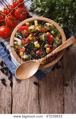 Mexican Vegetable Salad In A Wooden Bowl, Close-up Vertical Top View