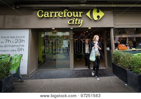 Woman leaves Carrefour City with her groceries