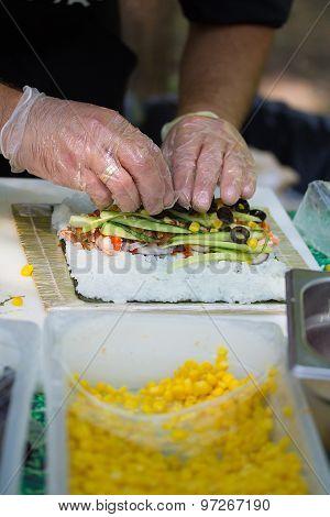 Chef Otdoors Is Prepairing Sushi Rolls, Fresh Ingredients.