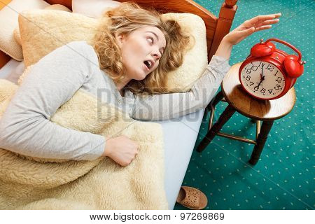 Woman Waking Up Late Turning Off Alarm Clock.