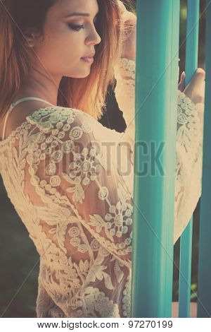 beautiful young woman portrait in summer  lacy dress  outdoor shot, retro colors