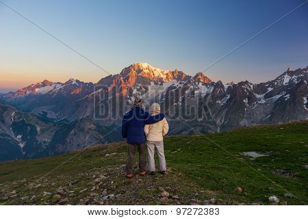 Couple Watching Sunrise Over Mont Blanc Summit