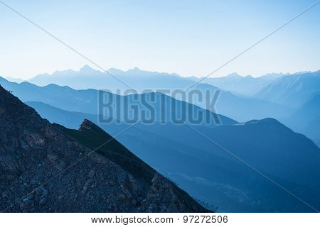 Blue Toned Mountain Silhouette At Sunrise