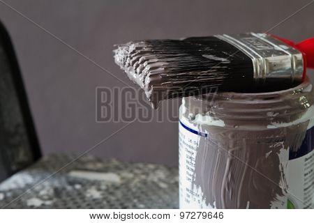Close Up Of Wet Paint Brush On Sample Pot Horizontal