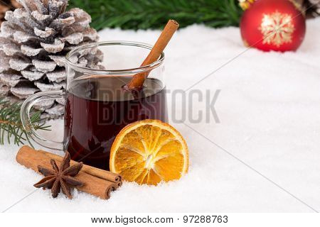 Mulled wine on Christmas in winter drinking alcohol drink decoration with snow and copyspace poster