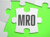 MRO - Jigsaw Puzzle with Missing Pieces. Bright Green Background. Close-up. 3d Illustration. poster