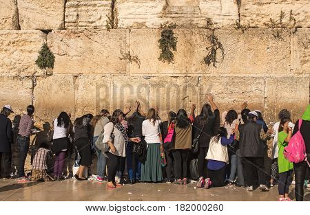 JERUSALEM ISRAEL - MAY 15 2014: The Western Wall Kotel or The Wailing Wall. The place where Divinity never departs. Female part.