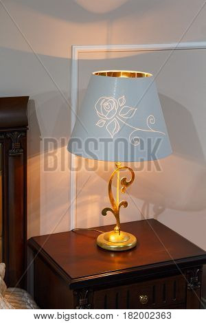 Lamp with a lampshade in the classic style in the bedroom. Interior